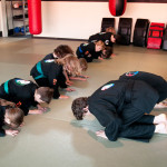 Kids Bowing during Martial Arts Class