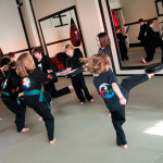 Kids Kicking during Martial Arts Class