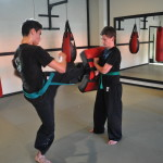 Youth Kicking During Martial Arts Class