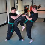 Youth Kneeing During Martial Arts Class